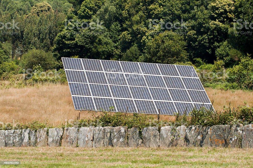 Solar panel on meadow, renewable energy, environmental conservation...