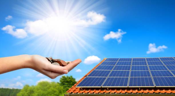 solar panel on the roof of the house. - pannelli solari foto e immagini stock