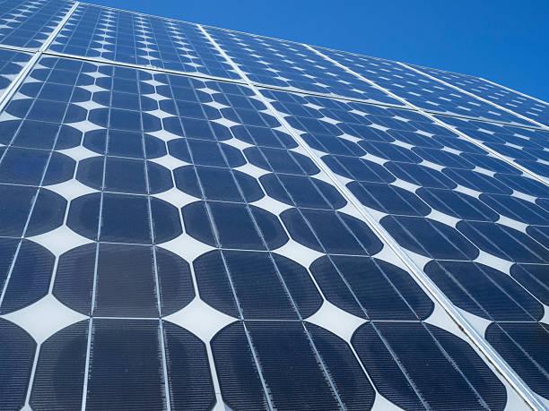 Solar panel photovoltaic cells blue sky stock photo