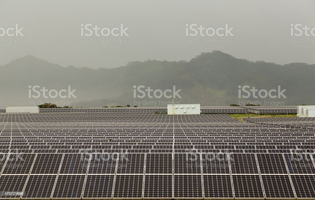 Solar panel power station on cloudy day stock photo