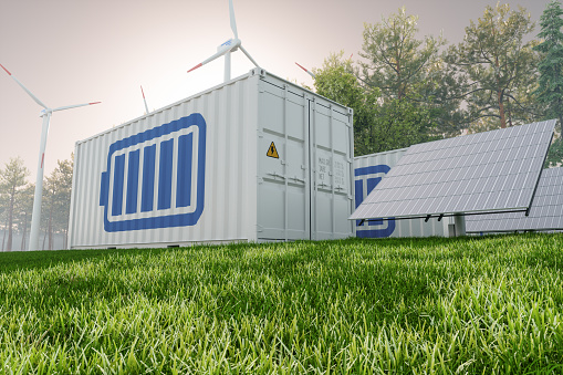 Solar Panel, wind turbines and Li-ion Battery Container With Blue Sky Background.  Energy Storage System.