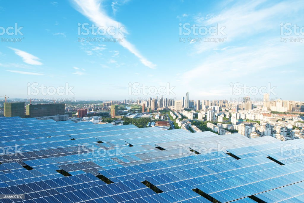 solar panel with cityscape of los angeles in cloud sky stock photo