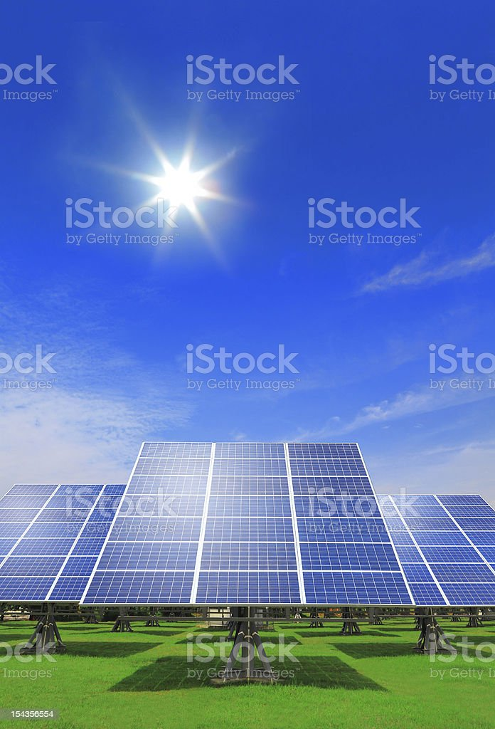 Solar Panel with green grass and beautiful blue sky royalty-free stock photo