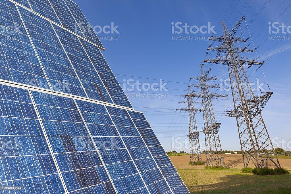 Solar panel with power poles stock photo