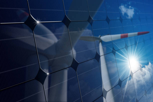 Solar Panel with Reflection of Wind Turbines - foto de stock