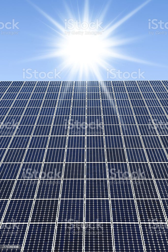 Solar panels against a sunny sky with many copyspace stock photo