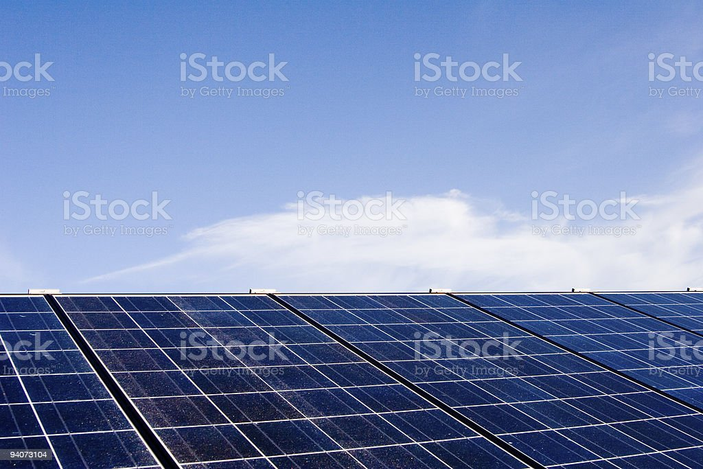 Solar panels against blue sky royalty-free stock photo