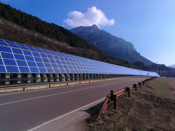 Solar panels along road or highway stock photo