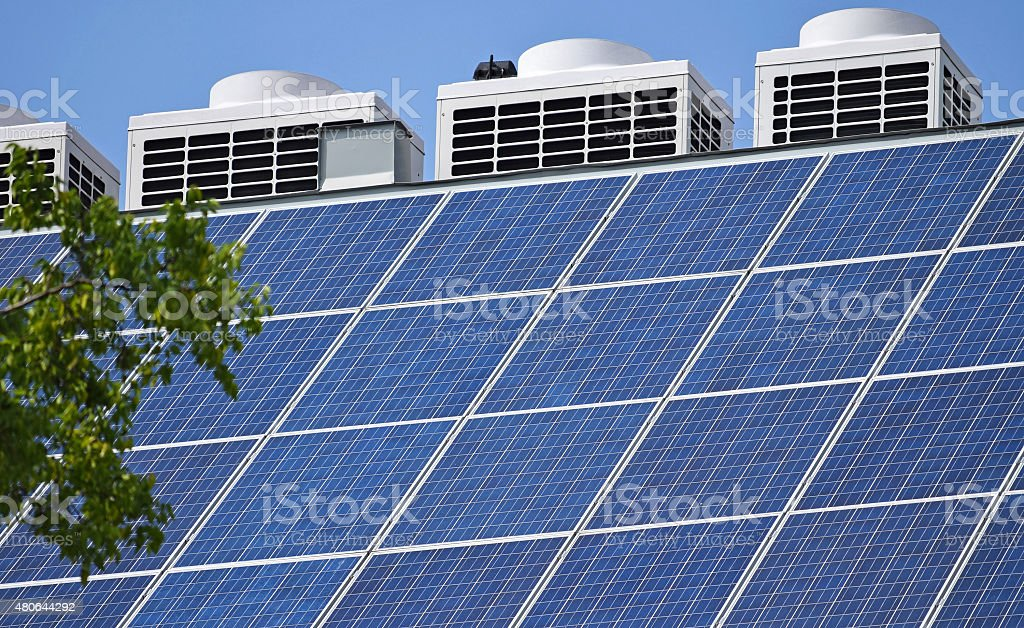 Solar Panels And Air Conditioners On The Roof Stock Photo - Download