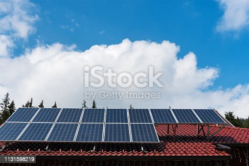 istock Solar panels and blue sky 1131598219