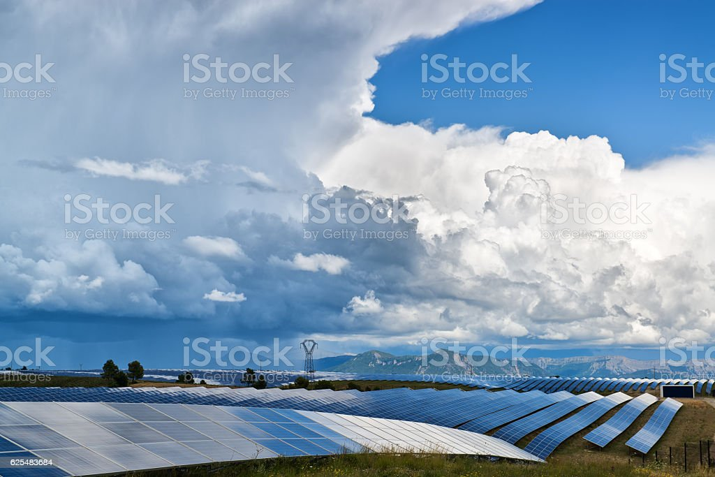 Solar panels and clouds stock photo