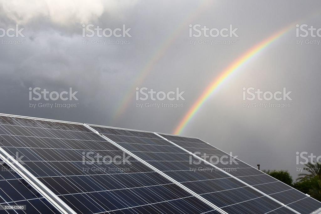 solar panels and rainbow stock photo