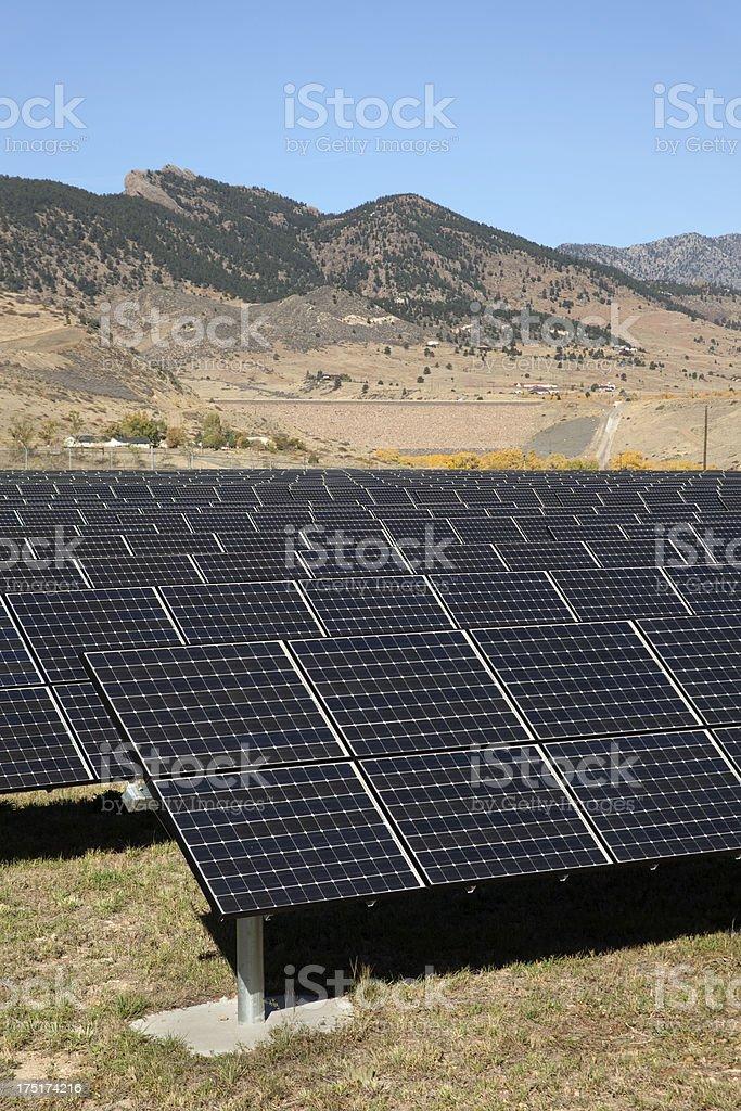 Solar panels and reservoir dam Colorado royalty-free stock photo