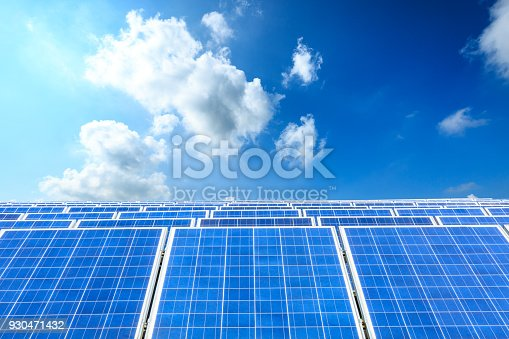istock solar panels and sky background,green energy 930471432