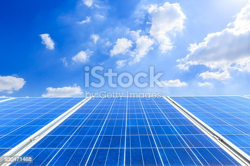 istock solar panels and sky background,green energy 930471468
