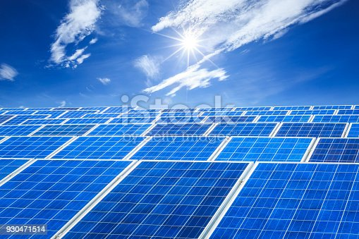 istock solar panels and sky background,green energy 930471514
