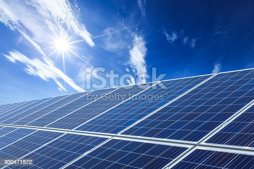 istock solar panels and sky background,green energy 930471572