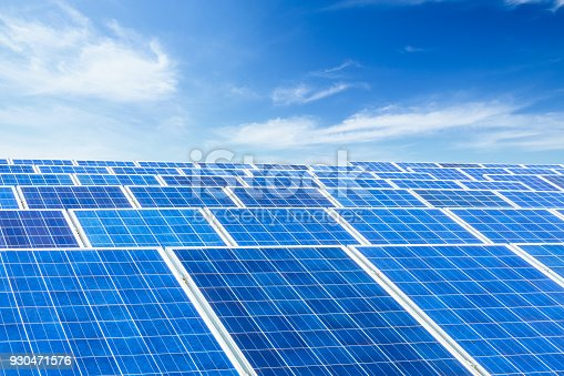 istock solar panels and sky background,green energy 930471576