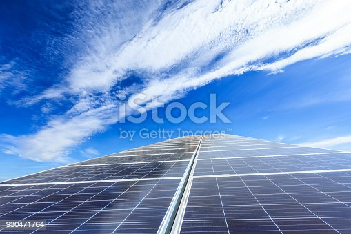 istock solar panels and sky background,green energy 930471764