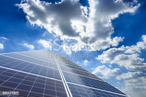 istock solar panels and sky background,green energy 930471922