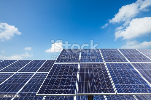 istock solar panels and sky background,green energy 930471926