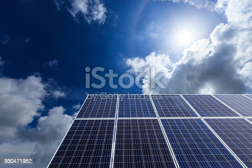 istock solar panels and sky background,green energy 930471952