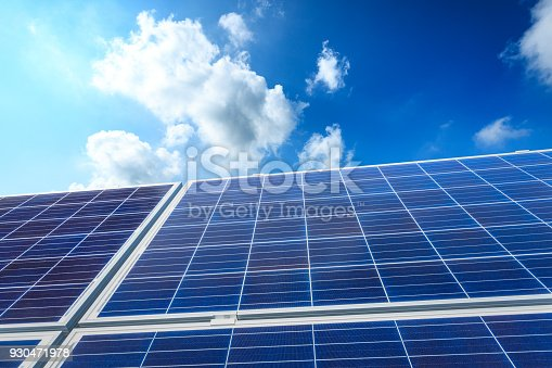 istock solar panels and sky background,green energy 930471978