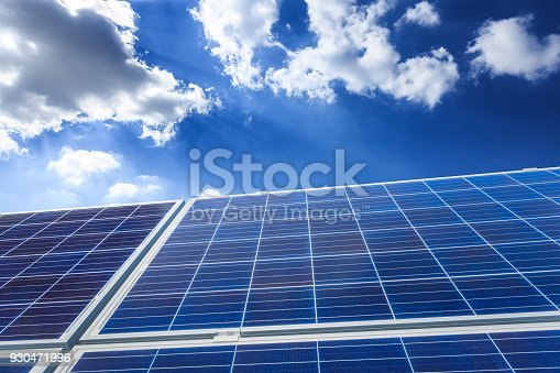 istock solar panels and sky background,green energy 930471996