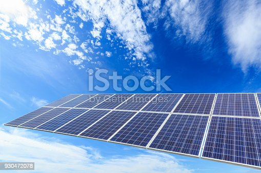 istock solar panels and sky background,green energy 930472078