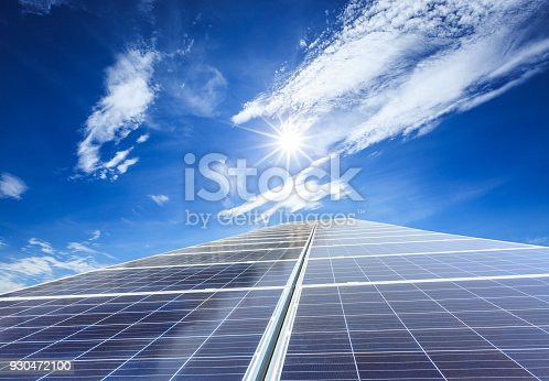 istock solar panels and sky background,green energy 930472100