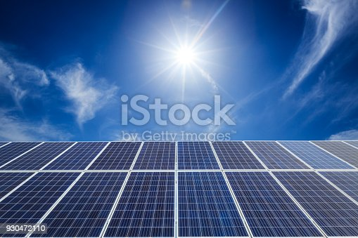 istock solar panels and sky background,green energy 930472110