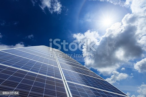 istock solar panels and sky background,green energy 930472154