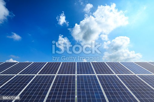 istock solar panels and sky background,green energy 930472168
