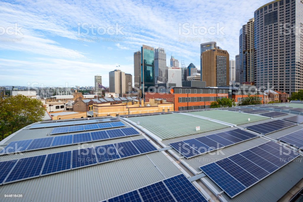 Solar panels and urban architecture stock photo