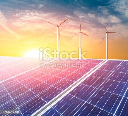 istock solar panels and wind generators at sunset 670628098
