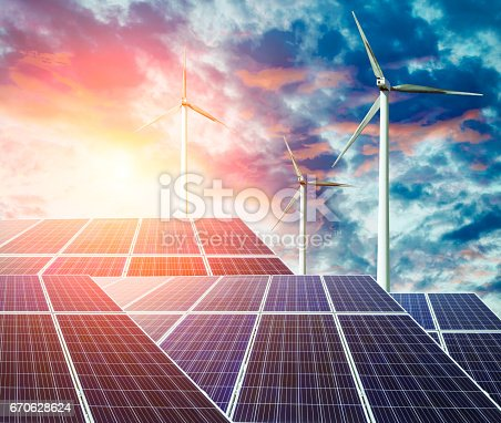istock solar panels and wind generators at sunset 670628624