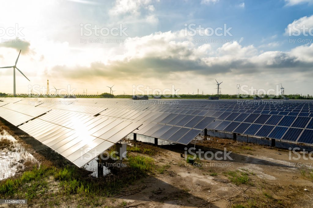 Solar panels and wind power, clean energy in nature stock photo
