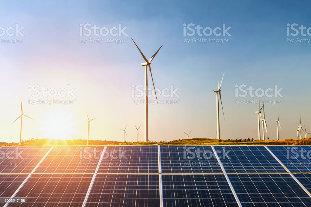 solar panels and wind turbine with sunset on the hill. concept idea clean energy royalty-free stock photo
