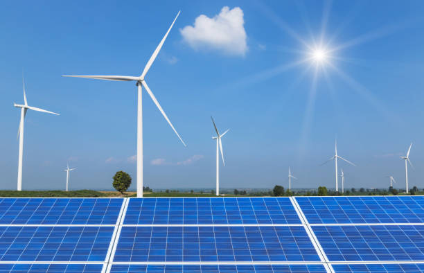 solar panels and wind turbines in  power station stock photo