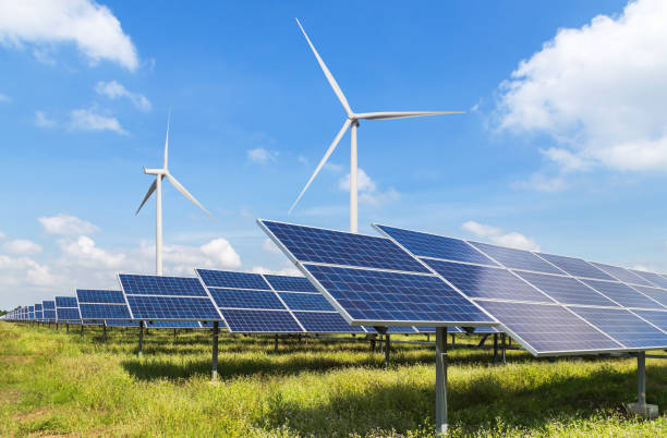 solar panels and wind turbines in power station solar panels and wind turbines generating electricity in power station green energy renewable with blue sky background sustainable energy stock pictures, royalty-free photos & images