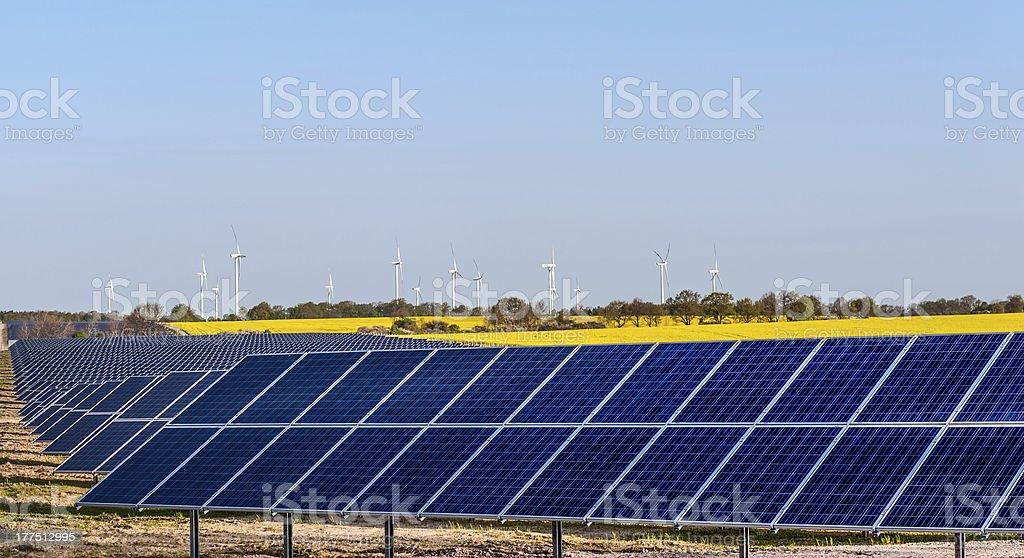 Solar panels and wind turbines stock photo