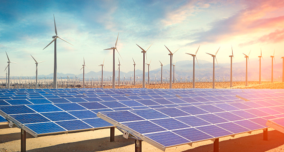 Solar Panels And Wind Turbines Producing Green Energy