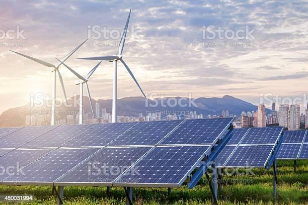 Solar panels and wind turbines with city picture id480031994?b=1&k=6&m=480031994&s=612x612&h= srp4choxezm3ojvntrjflagmli3v7tasdi2uoc0fzu=