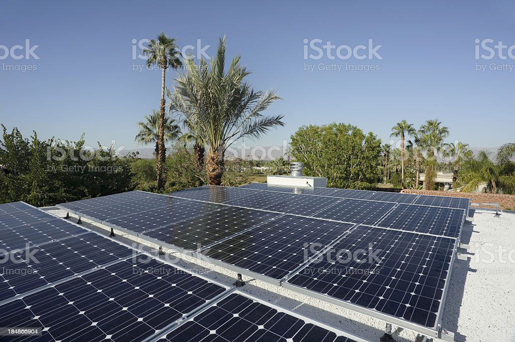 solar panels at work in the sunshine stock photo
