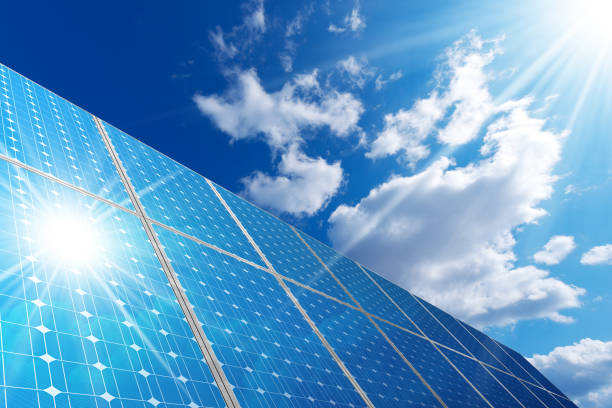 solar panels - blue sky clouds and sun rays - solar panels stock pictures, royalty-free photos & images