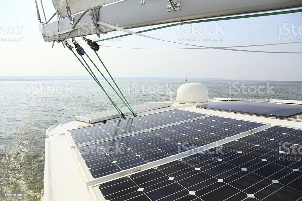 Solar Panels Charging Batteries Aboard Sail Boat Stock Photo