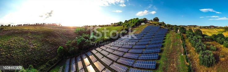 1170098138istockphoto Solar panels fields on the green hills 1028452320