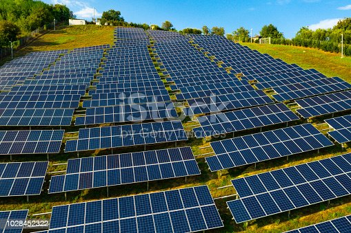 1170098138istockphoto Solar panels fields on the green hills 1028452322