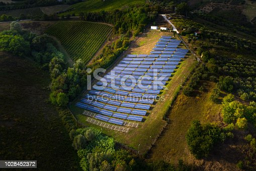 Solar panels fields on the green hills in Italy