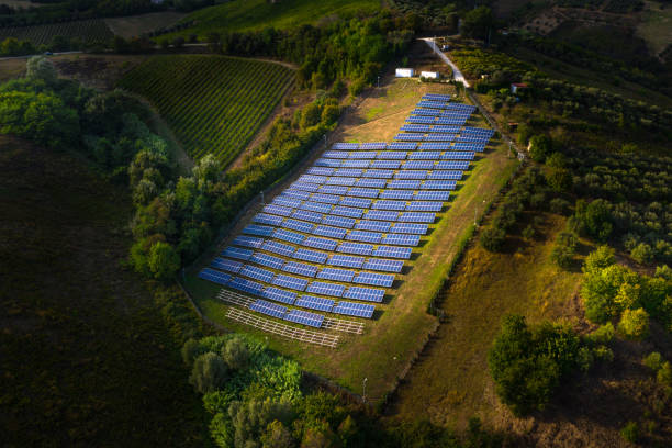 Solar panels fields on the green hills stock photo